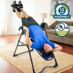 Man exercise in a room with the Best Inversion Table