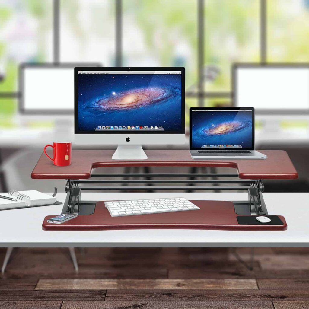 Adjustable Computer Desk with desktop and laptop that indicates it's usefulness