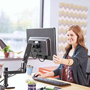 A woman cheers with the using of the Best Monitor Mount in her workplace