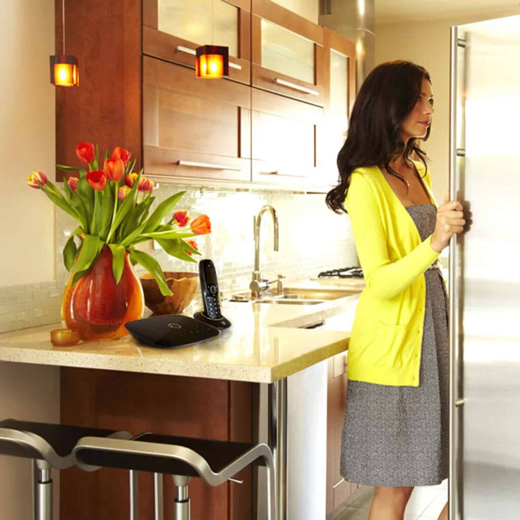 Woman feel relax at home for the unlimited calling with the VoIP Home Phone service