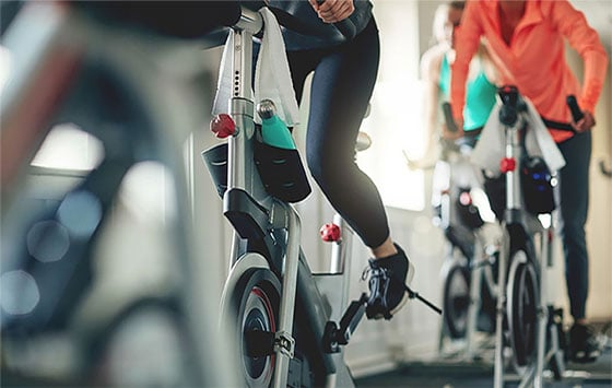 Healthcare conscious people are practicing with fitness equipment.